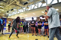 Former Navy Seal Al Horner and instructor Karla Rapp demonstrate to young women and mothers at Minnetonka High School on what to do if you are attacked at gunpoint at the July 22 course. (Sun Sailor p